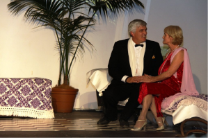 Part of the appeal of Hay Fever can be seen in the setting and costuming elegance in this scene featuring Bob Hitchens and Anna Swift – a style followed through in the three acts of the production.